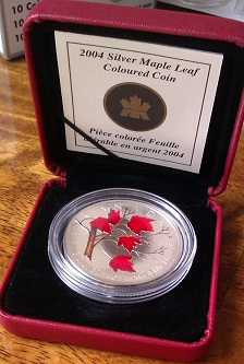 Coloured Maple Leaf met box - troy ounce zilver